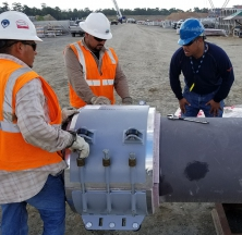 Rilco Team Member Instructing on PyroWrap Pipe Support Installation